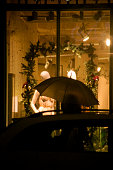 istock Detail of an illuminated store window with Christmas decorations at night. 1292116283