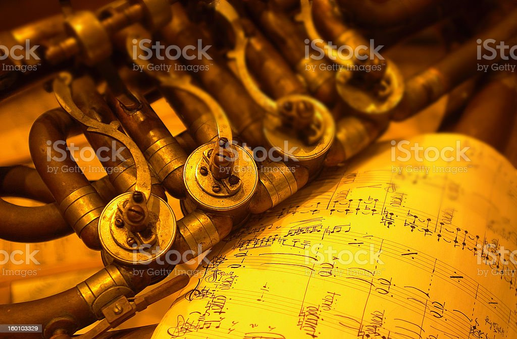 Detail of an old brass instrument royalty-free stock photo