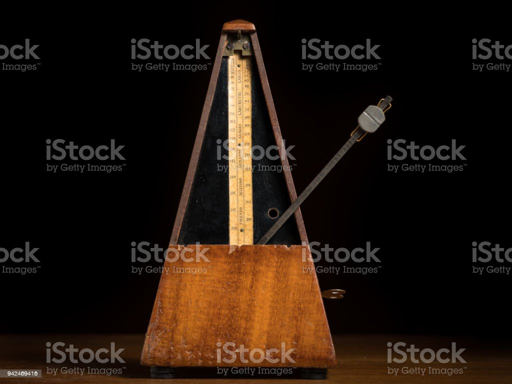 Detail of an old mechanic musical metronome stock photo