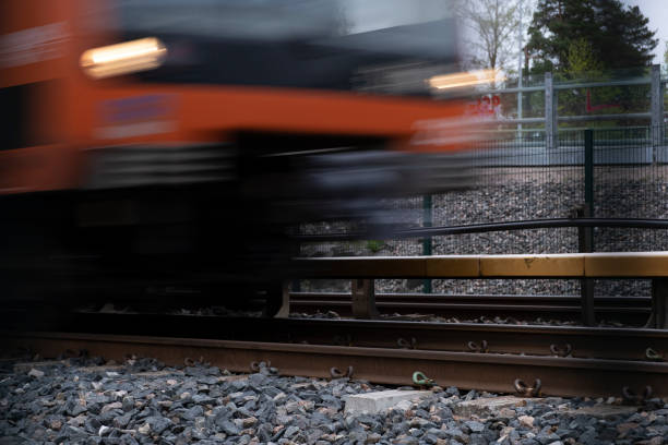 A detail of an underground rails with a blurred metro passing by. stock photo