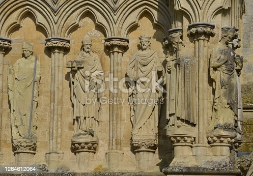 Close up detail of five Anglican bishops on external wall of Salisbury Cathedral in Salisbury, England