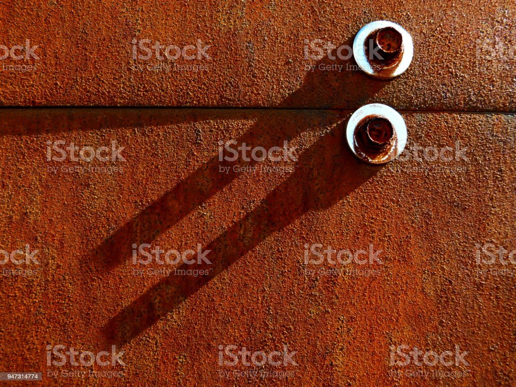 detail of artificially rusted steel plates and bolts stock photo