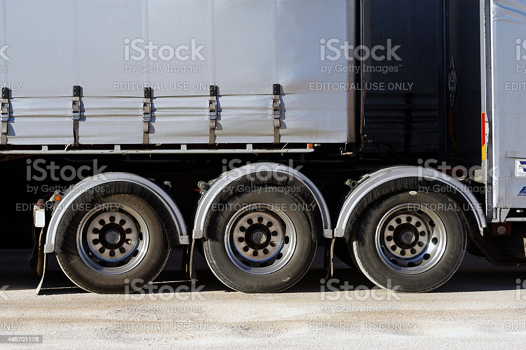 Detail of Australian truck wheels Victoria, Australia - may 20, 2007: Detail of the wheels of a large truck called Australian road train in Australia because they can carry up to six trailers across the country 2015 Stock Photo