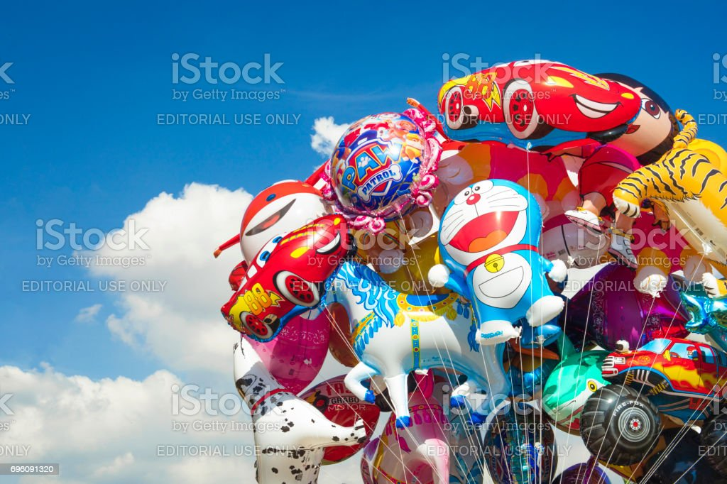 Detail  of balloons of popular cartoons, which are sold to children at parks and playgrounds stock photo