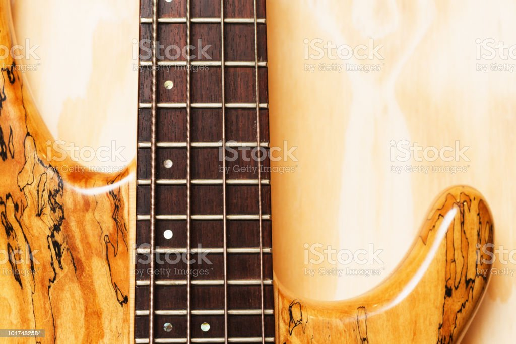 Detail of bass guitar made of spalted maple stock photo