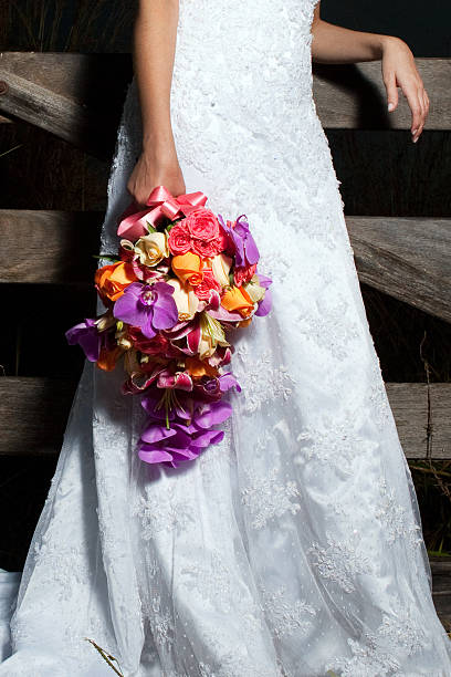 Detail of Beautiful Bride's Dress and Bouquet in a farm - foto de acervo
