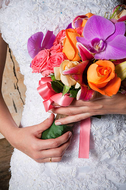 Detail of Beautiful Bride's Flower Bouquet and Hands - foto de acervo
