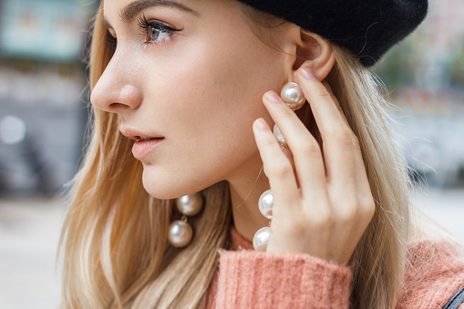 istock Detail of beautiful woman with earring 628219220