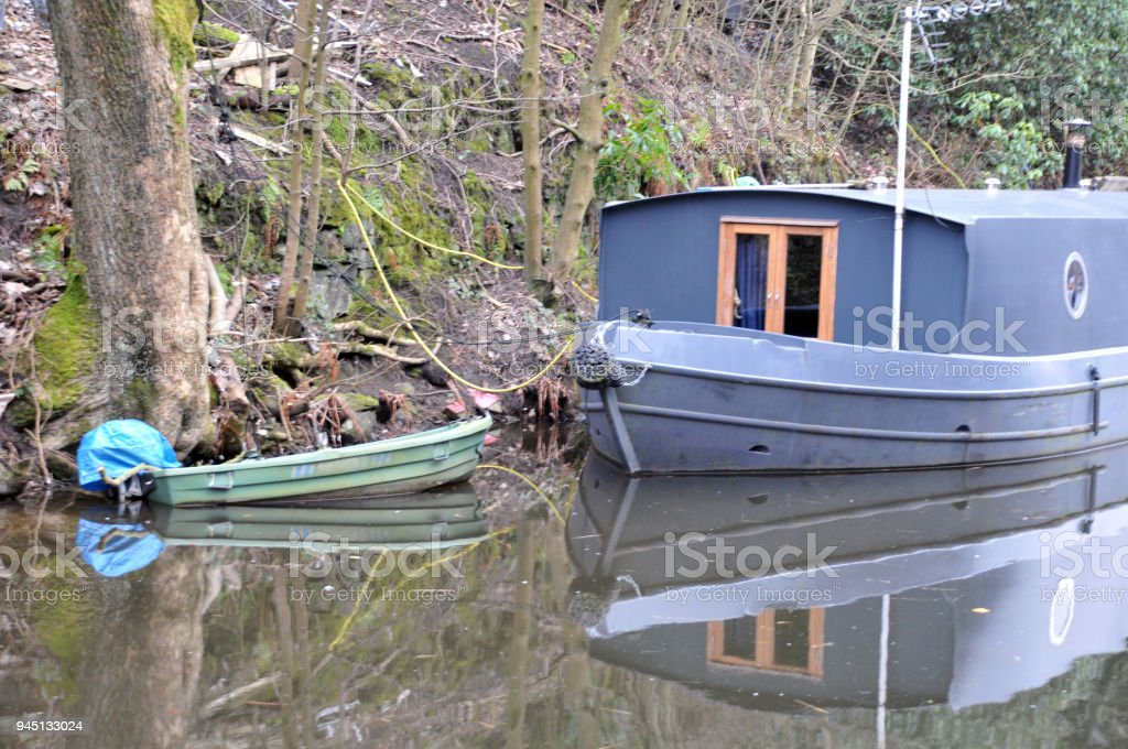 Detail Of Blue Houseboat Converted Barge Moored On A Canal