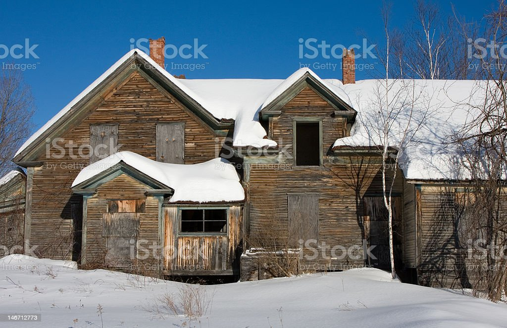 Detail of Boarded up and Abandoned House in Winter stock photo