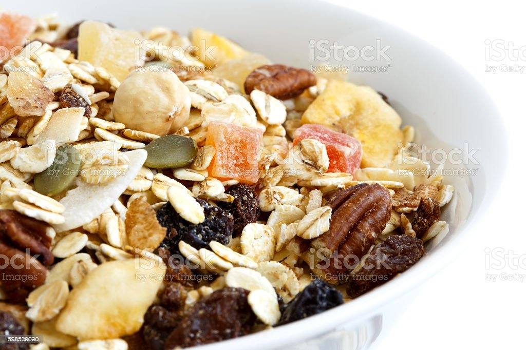 Detail of breakfast bowl of fruit and nut muesli. photo libre de droits