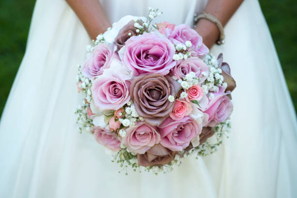 detail of bride holding bridal bouquet stock photo