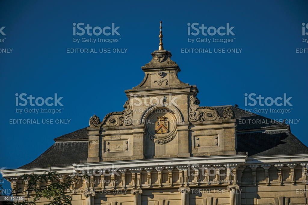 Detail of building facade at sunset and blue sky in the City Center of Tielt. stock photo