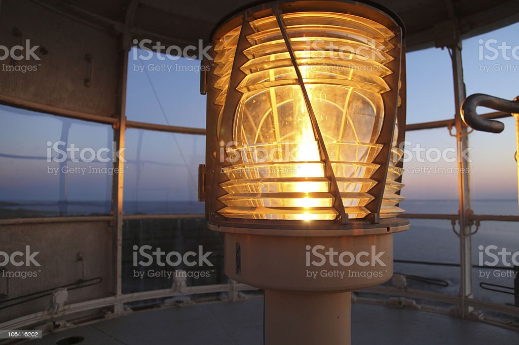 detail of bulb flashing in lighthouse stock photo