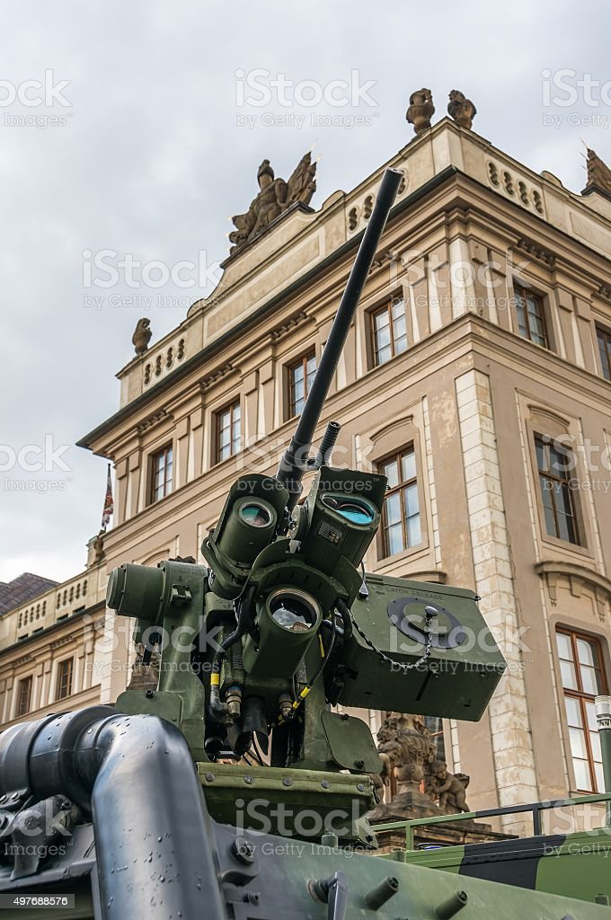 Detail of cannon tube (machine gun) and armored military vehicle stock photo