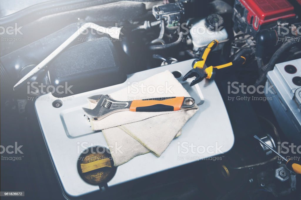 detail of  car engine with tools stock photo