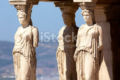 istock Detail of Caryatid Porch on the Acropolis, Athens, Greece. Ancient Erechtheion or Erechtheum temple. World famous landmark at the Acropolis Hill. 1347239645