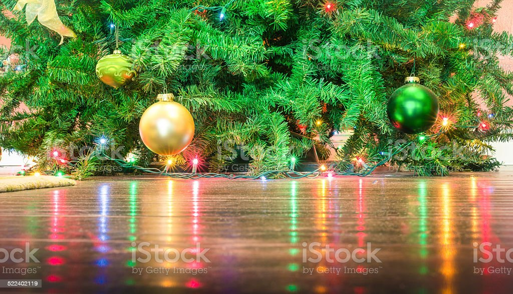 Detail of Christmas tree decorations with lights reflections stock photo