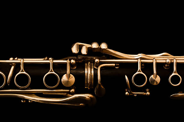 detail of clarinet on black background - classical stock photos and pictures