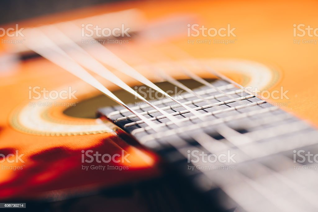Detail of classic guitar with shallow depth of field stock photo