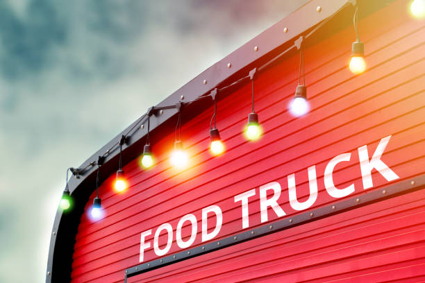 detail of closed red food truck with light bulb background, no people detail of closed red food truck with light bulb background, no people food truck stock pictures, royalty-free photos & images