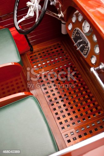 Beautiful tongue and groove wooden flooring in this beautifully restored classic wooden speedboat.