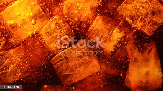 Detail of cola drink with ice cubes, fresh beverages background.