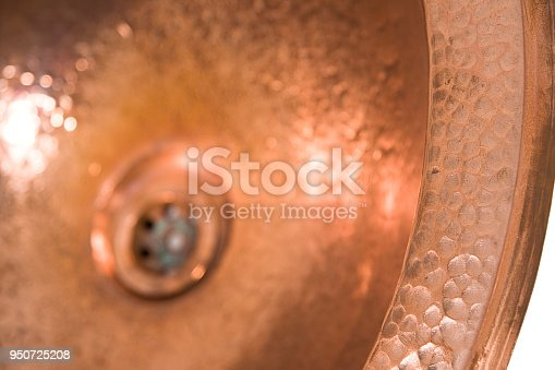 istock Detail of copper round sink. Brown copper sink in retro style. Antique sink for home. Macro shooting. 950725208
