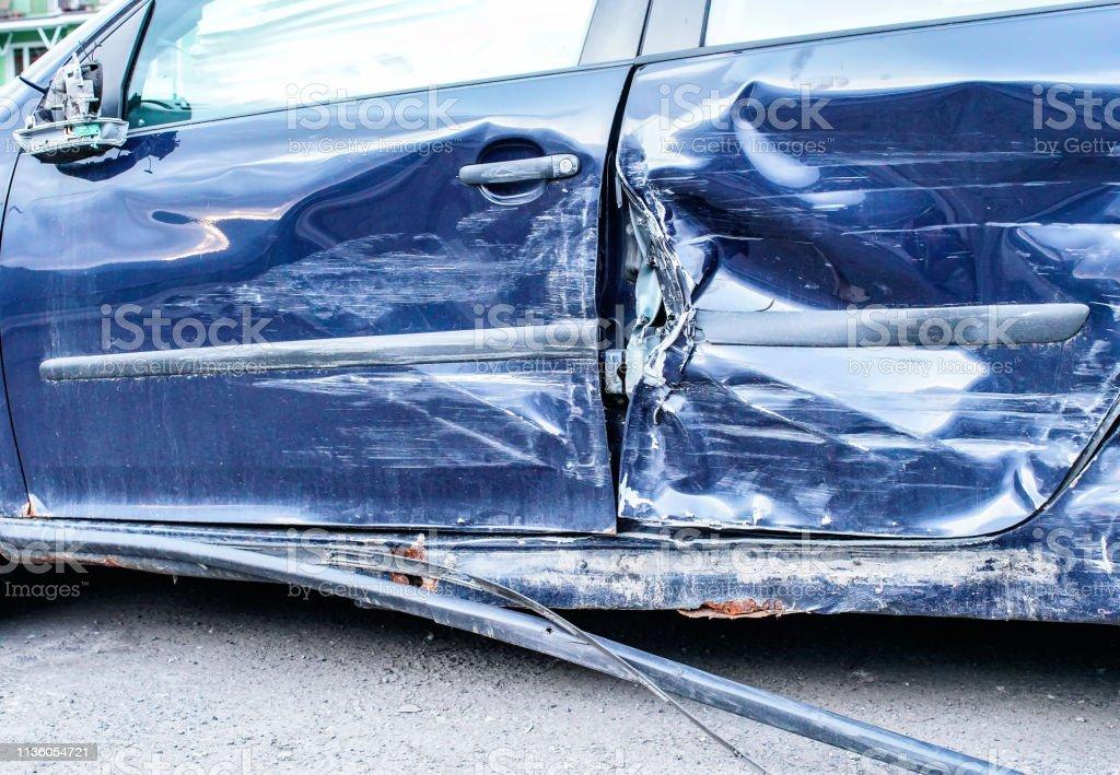 Detail of crashed car after accident, blue metal plates on side door...