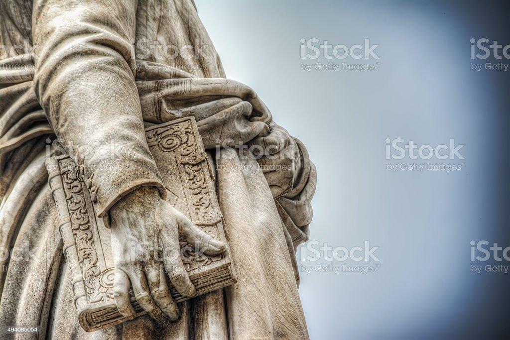 detail of Dante Alighieri statue stock photo