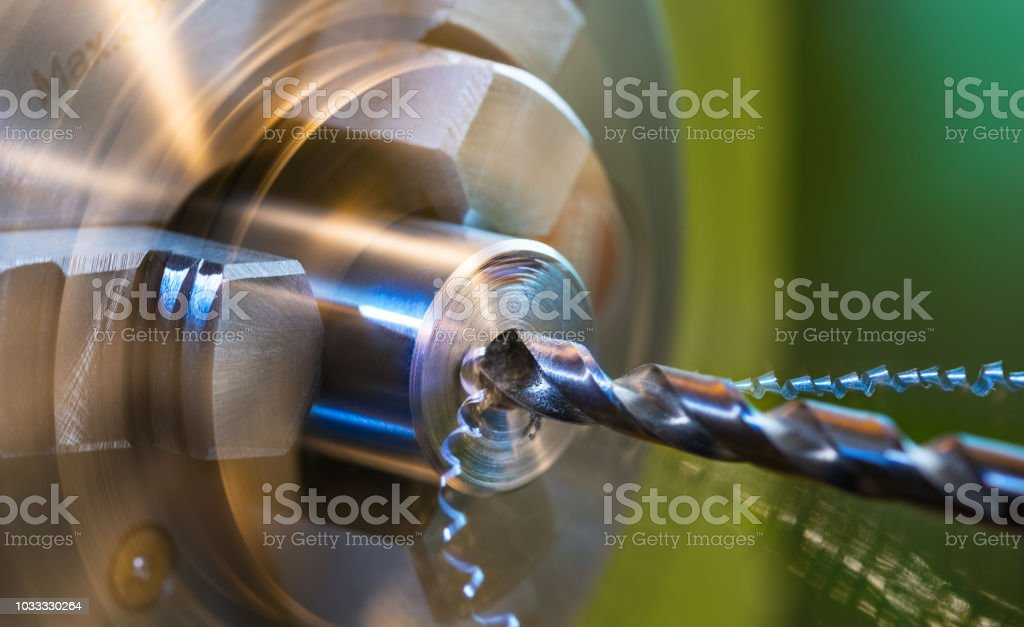 Detail of drilling on a lathe with metal shavings stock photo