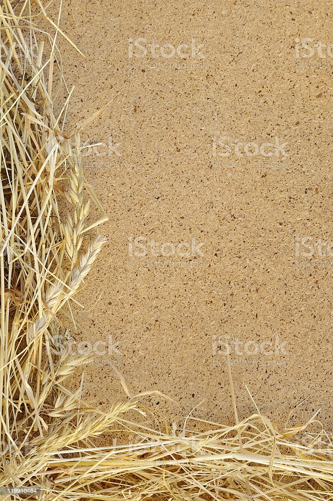 Detail of dry grass hay and OSB, oriented strand board royalty-free stock photo