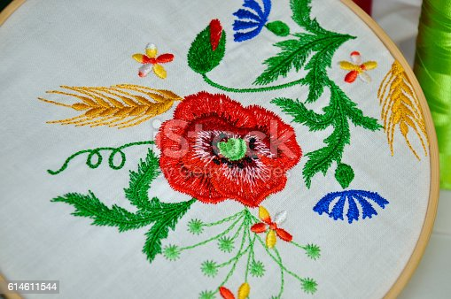 istock Detail of embroidery flower ornament in wooden hoop 614611544