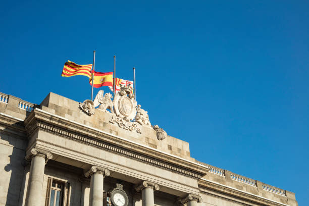 Detail of Facade of Barcelona's City Council with flags flying at half mast as a sign of mourning stock photo