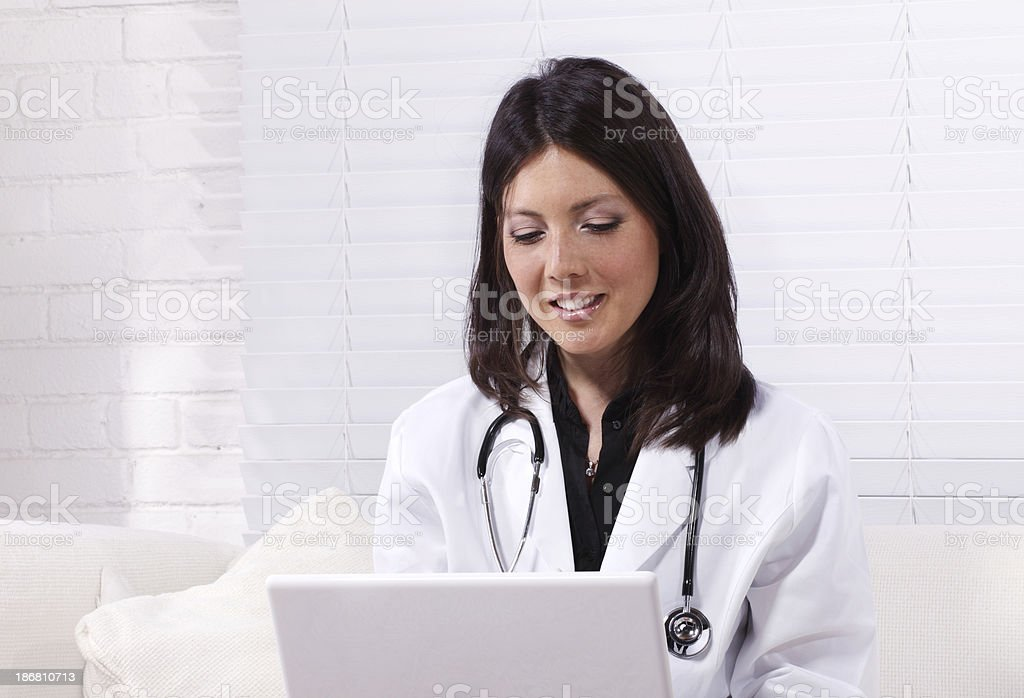 Detail of Female doctor with laptop royalty-free stock photo