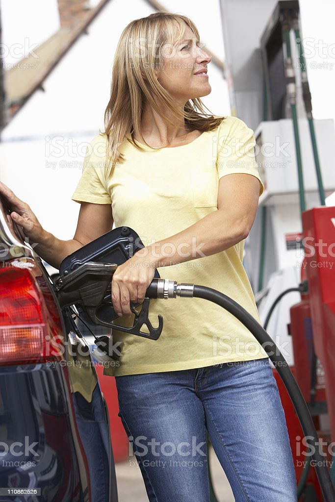 Detail Of Female Motorist Filling Car With Diesel stock photo