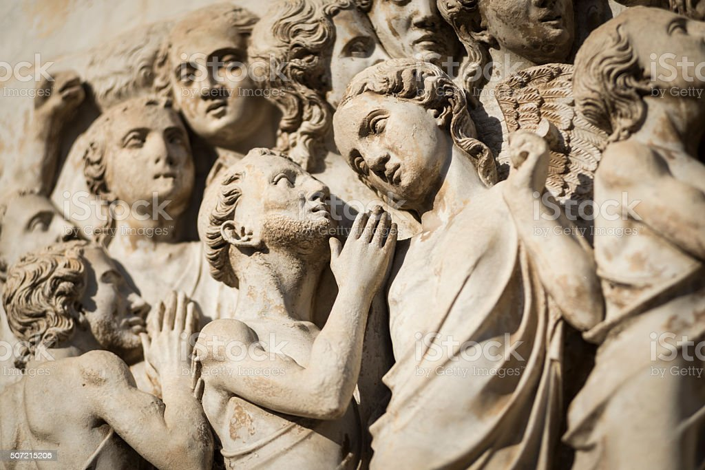 Detail of figures on relief of the cathedral in Orvieto stock photo
