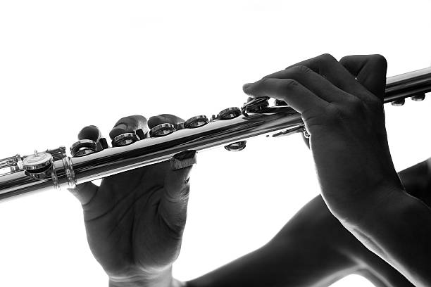 B&W detail of flute keys and hands stock photo