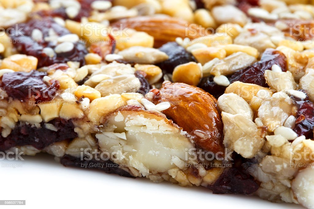 Detail of fruit, nut and seed bar with cranberries. photo libre de droits