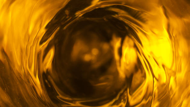Detail of fuel oil whirl Detail of fuel oil whirl, abstract energy consumption background oil stock pictures, royalty-free photos & images