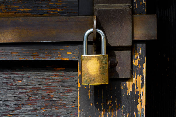 Detail of gate closure with padlock stock photo