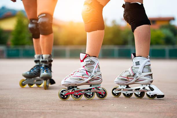 Detail of girls rollerblading – Foto