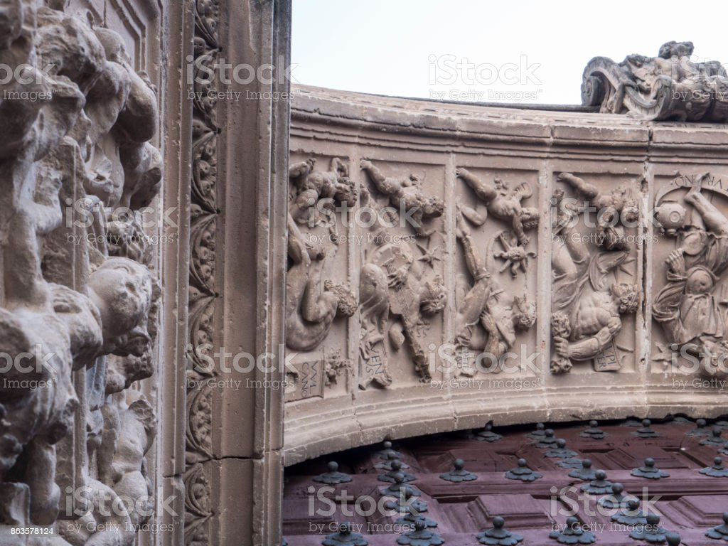 Detail of gods in stone at the door entrance of the sacred Chapel Church El Salvador, work of Andres de Vandelvira and Diego de Siloe, Ubeda, Spain stock photo
