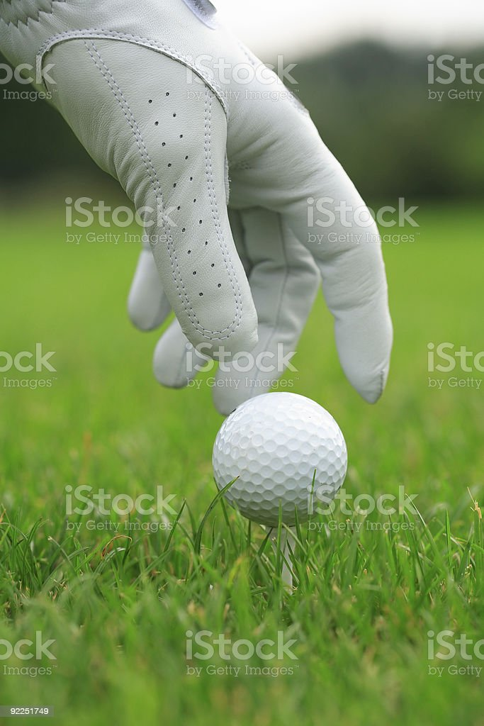Detail of golf ball and gloves royalty-free stock photo