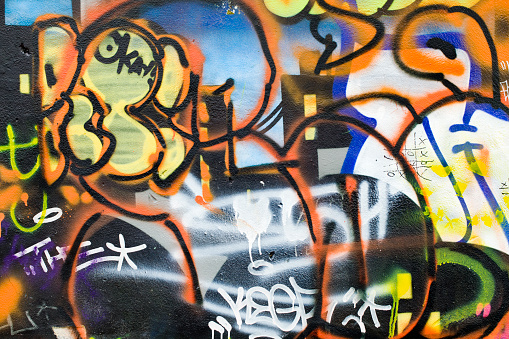 Close up of graffiti on wall of abandoned building.