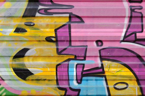 Detail of graffiti on noice barrier along railway.