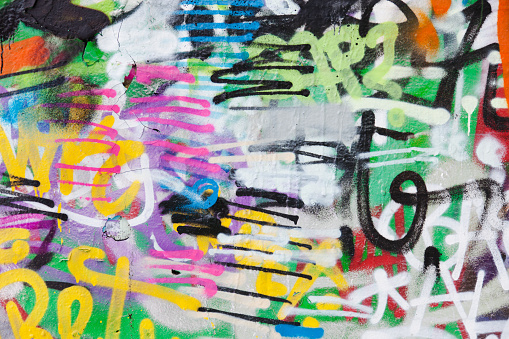 Detail of graffiti painted illegally on public wall.