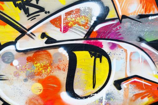 Copenhagen, Denmark - December 30, 2011: Small detail of large colorful illegal piece of graffiti on wall of abandoned building in Copenhagen, Denmark.