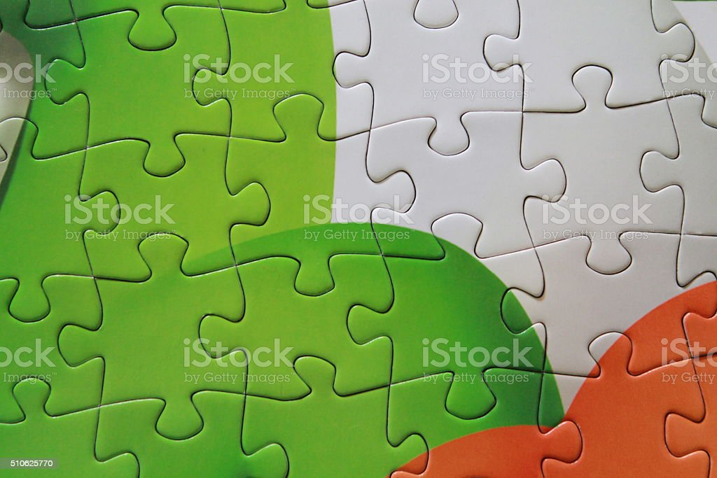Detail of green puzzle pieces put together stock photo