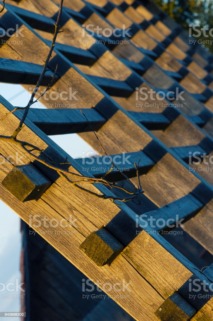 Detail of hayrack side-lit by golden sunlight stock photo